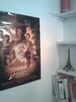 The poster and the Eiffel Tower at its left